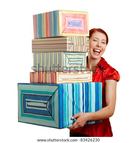 Happy smiling woman carrying many christmas gifts