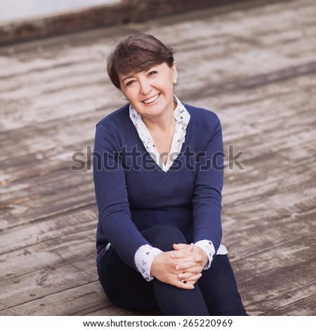 Happy smiling woman close-up - stock photo