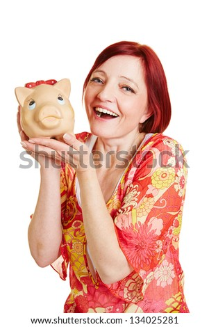 Happy smiling woman holding a big piggy bank - stock photo
