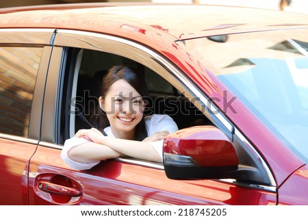 Happy smiling woman in a car. Driving. - stock photo