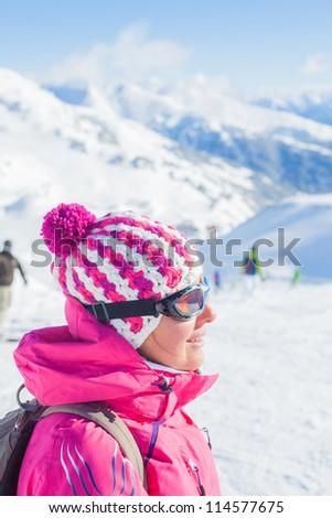 Happy smiling woman in ski goggles, Zellertal, Austria - stock photo