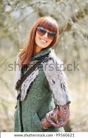 Happy smiling woman in sunglasses outdoors. Close up portrait - stock photo