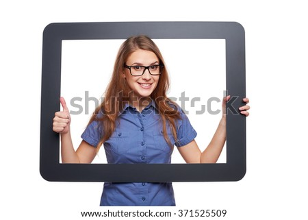 Happy smiling woman looking through frame and showing approving gesture, over white background - stock photo