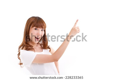 happy, smiling woman pointing at blank space