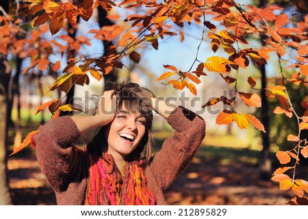 Happy smiling woman portrait in autumn park.  - stock photo