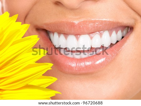 Happy smiling woman with a healthy teeth. Dentist. - stock photo