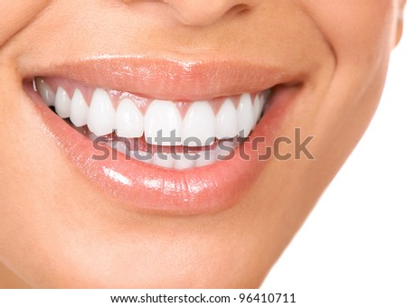 Happy smiling woman with a healthy teeth. Dentist. Isolated on white background.