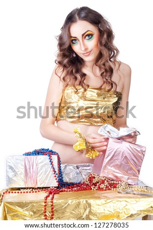 happy smiling woman with bright make-up making gift over white - stock photo