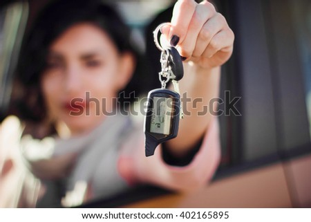 Happy smiling woman with car key