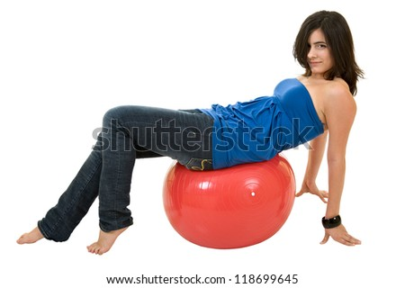 Happy smiling woman with fitness ball - stock photo
