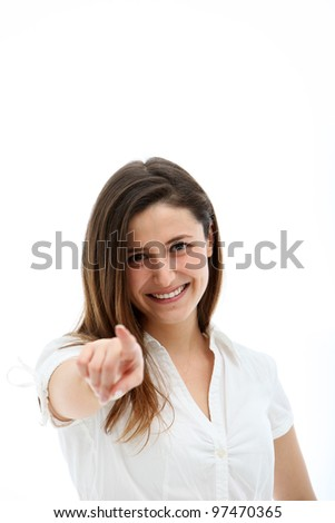 Happy smiling woman with natural expression pointing her finger directly at the camera - stock photo
