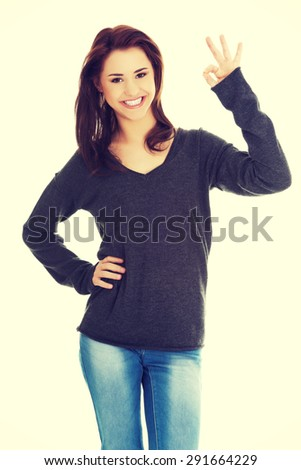 Happy smiling woman with perfect hand sign - stock photo
