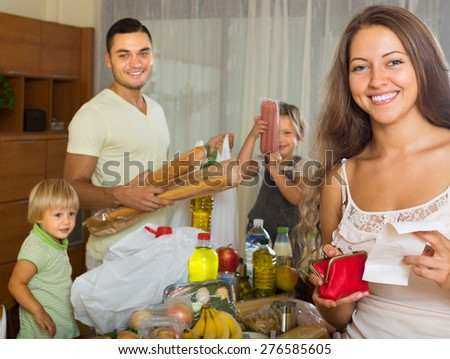 Happy smiling woman with receipt from store, family brought food home