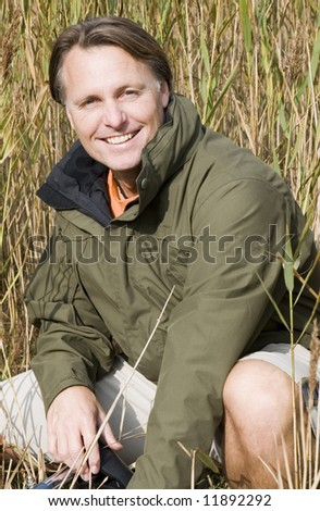 Happy smiling 43 year old man. - stock photo