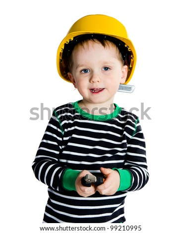 Happy smiling 2-3 years old boy in yellow helmet playing with pliers - isolated on white background