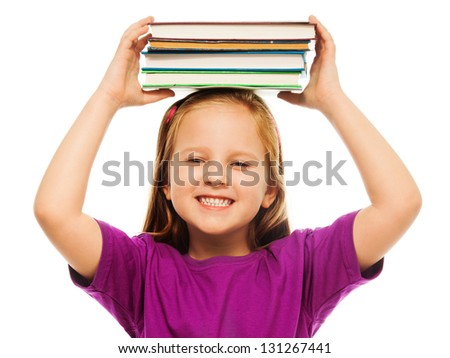 Happy smiling 6 years old girl closeup portrait isolated on white holding stack books on top of her head - stock photo