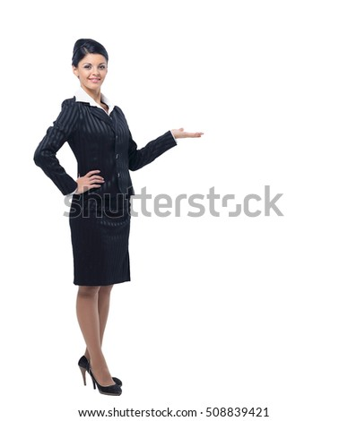 Happy smiling young beautiful business woman showing blank area