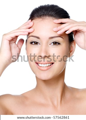 Happy smiling young beautiful woman touching her forehead without wrinkles - close-up