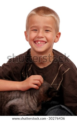 Happy smiling young boy with his cat on his lap - stock photo