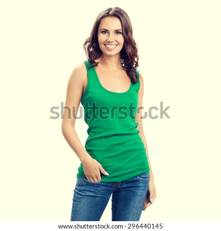 happy smiling young brunette woman in smart green casual clothing - stock photo