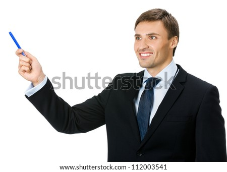 Happy smiling young business man showing blank area for sign or copyspase with marker, isolated over white background