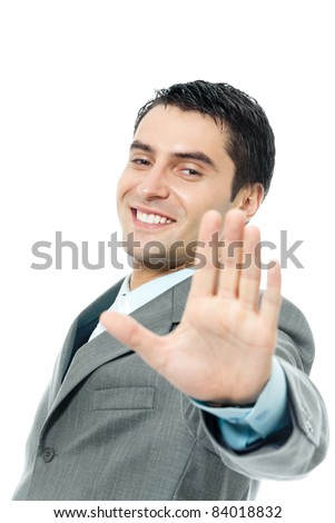 Happy smiling young business man showing stop gesture, isolated over white background