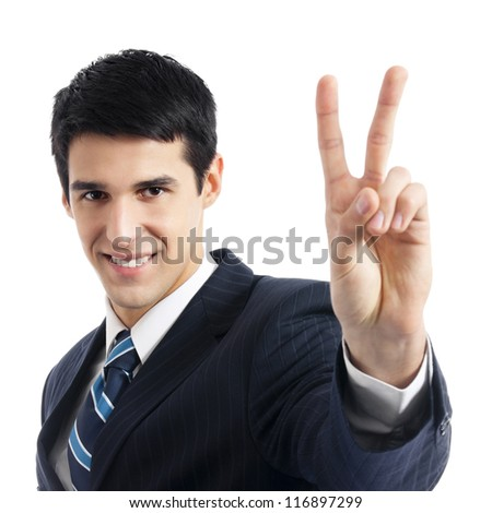 Happy smiling young business man showing two fingers or victory gesture, isolated over white background