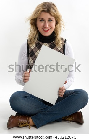 Happy smiling young business student woman showing blank signboard on white background - stock photo