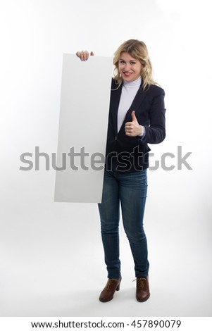 Happy smiling young business student woman standing showing blank signboard on white background - stock photo