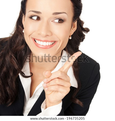 Happy smiling young business woman showing blank area for sign or copyspase, isolated on white background - stock photo