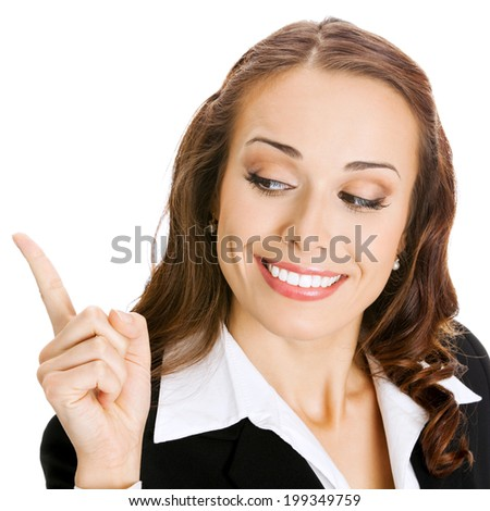 Happy smiling young business woman showing blank area for sign or copyspase, isolated over white background