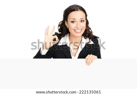 Happy smiling young business woman showing blank signboard, placard or banner, isolated over white background