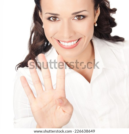 Happy smiling young business woman showing four fingers, isolated on white background - stock photo