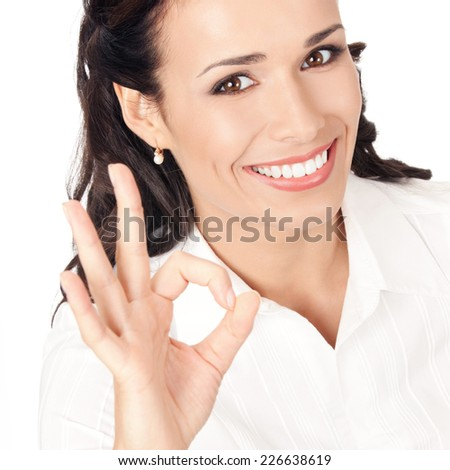 Happy smiling young business woman showing okay gesture, isolated on white background - stock photo