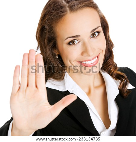 Happy smiling young business woman showing stop gesture, isolated against white background