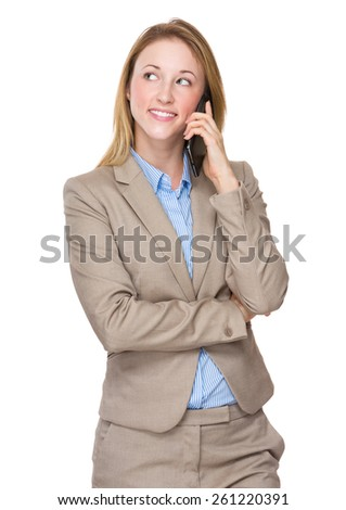 Happy smiling young businesswoman with cellphone - stock photo