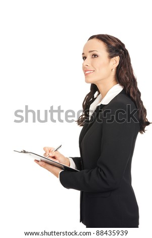 Happy smiling young businesswoman with clipboard writing, isolated on white background