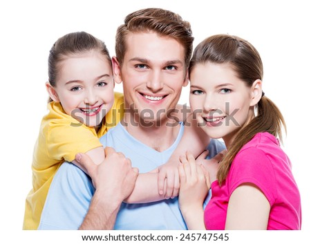 Happy smiling young family with little girl in colored shirts looking at camera - isolated on white.