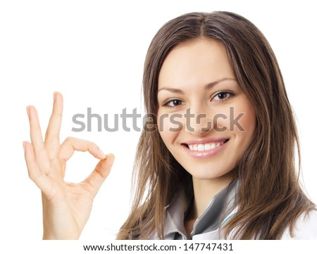 Happy smiling young female doctor with okay gesture, isolated over white background