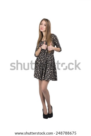 Happy smiling young lady with OK hand sign. Full body portrait of young Caucasian lady makes OK hand sign. Bright casual dress and white background. - stock photo