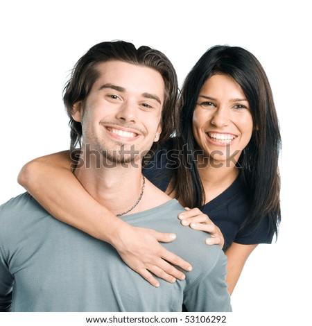 Happy smiling young latin couple piggyback isolated on white background - stock photo