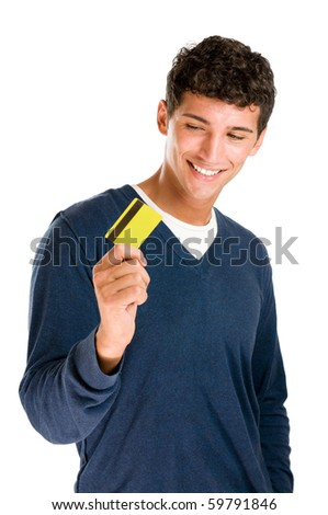 Happy smiling young man looking at his credit card isolated on white background