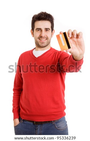Happy smiling young man showing credit card isolated on white background - stock photo