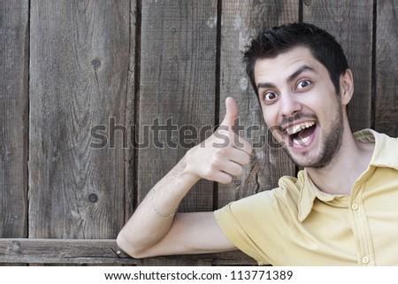 Happy smiling young man with okay gesture - stock photo