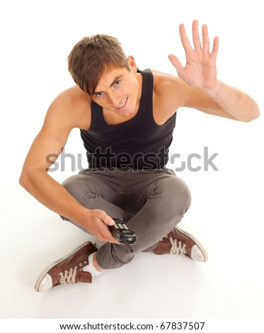 happy, smiling young man with raised arm, waving hello - stock photo