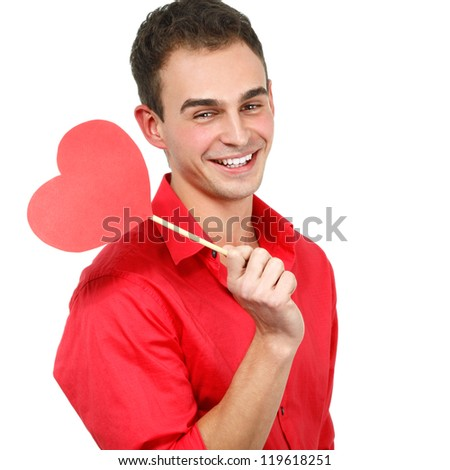 happy smiling young man with red love hear holiday valentine symbol over white background