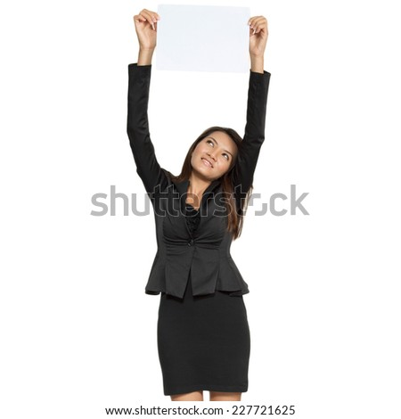 Happy smiling young pretty attractive brunette business woman standing showing blank signboard isolated on white background