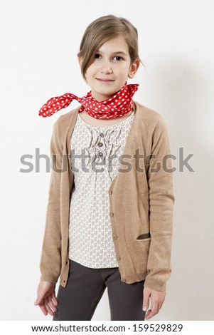 Happy smiling young student wearing res spot scarf - stock photo