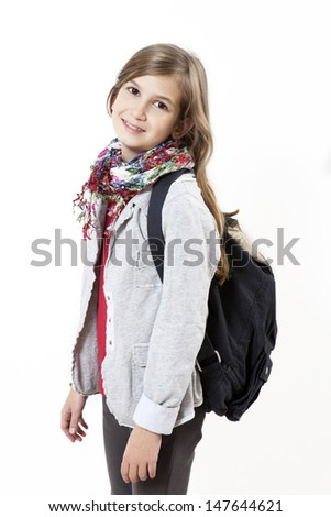 Happy smiling young student with her school bag - stock photo