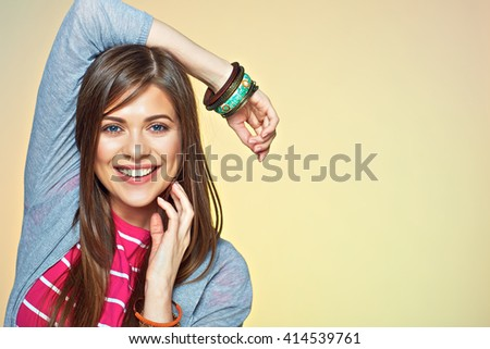 Happy smiling young woman close up face portrait. Smile with teeth. Yellow isolated. - stock photo